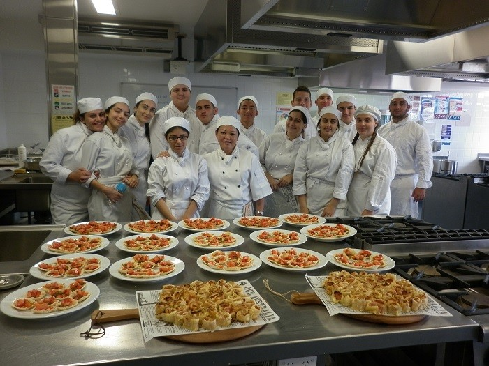 Students demonstrating food preparation